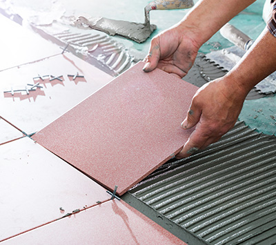 Laying Pink Tile
