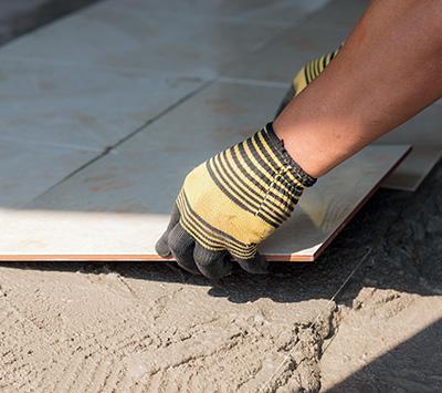 Man Setting Floor Tile