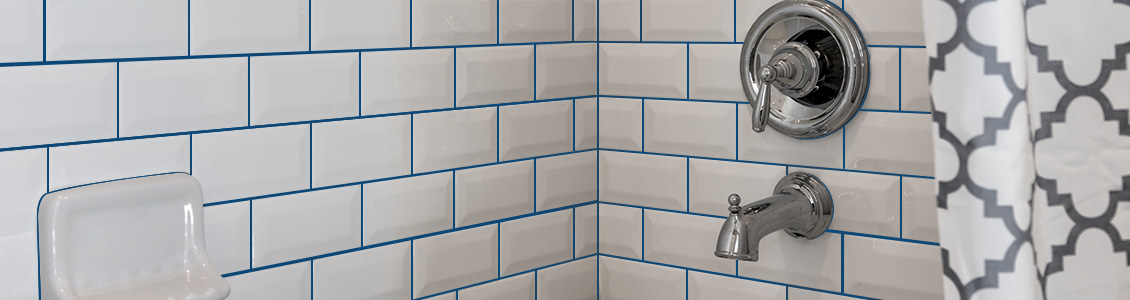 Picture of Bright White Tiles with Light Blue Design Grout Color