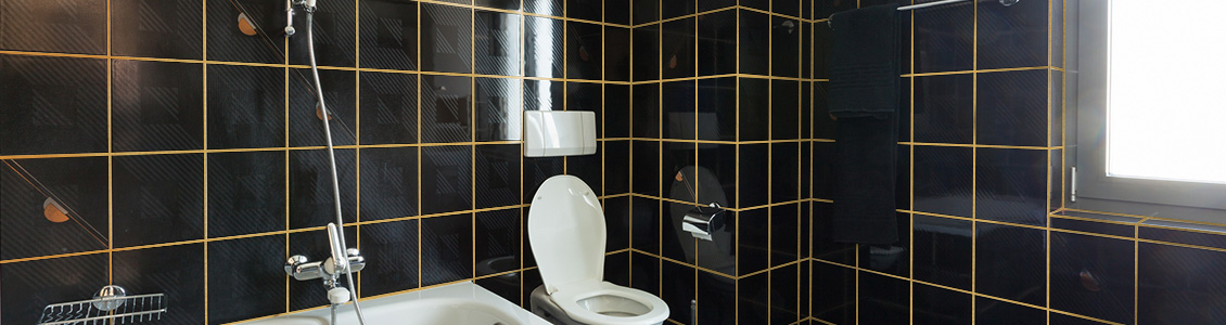 Picture of Black Tiles with Golden Design Grout Lines