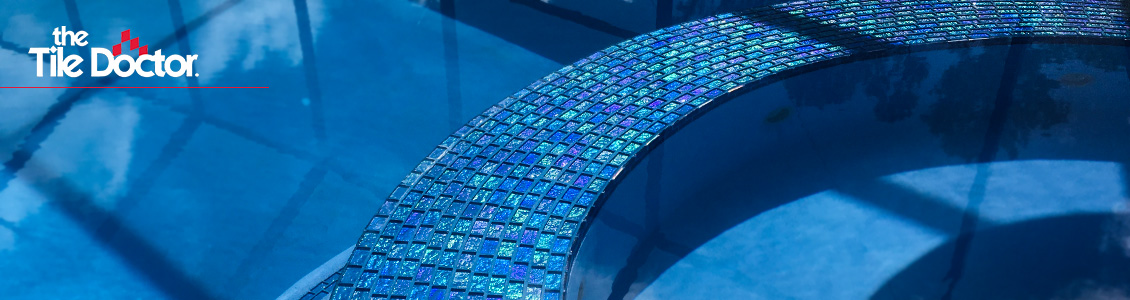 Image of Infinity-Edge Hot Tub with Blue Iridescent Tile and Epoxy Grout